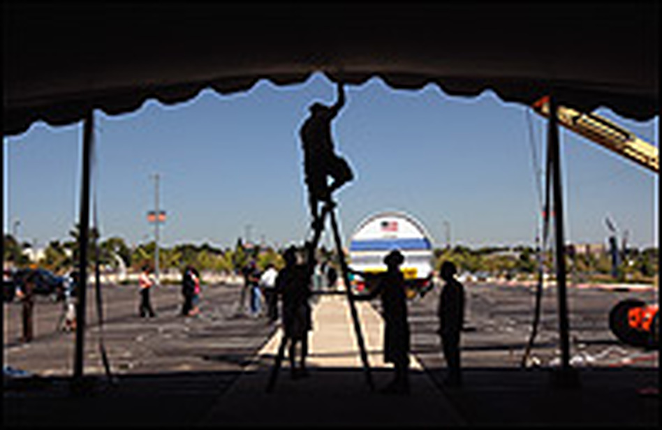 Workers prepare the exhibition tent at Invesco Field, site of the finale of the 2008 Democratic National Convention in Denver.