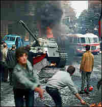 Prague residents carry a Czechoslovak flag and throw burning torches.