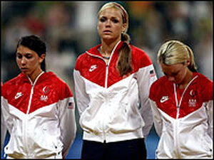 Andrea Duran (from left), Jennie Finch and Caitlin Lowe of the United States prepare to receive their silver medals after their team lost, 3-1, to Japan during the women's final medal softball game in Beijing.
