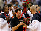 Head coach Mike Krzyzewski of the United States receives a gold medal