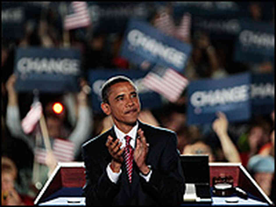 Barack Obama claps along with the crowd during his acceptance speech