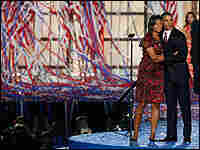 Michelle Obama joins her husband, Barack Obama, on stage in Denver as confetti falls