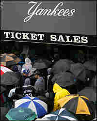 Fans line up at Yankee Stadium ticket windows after the game.