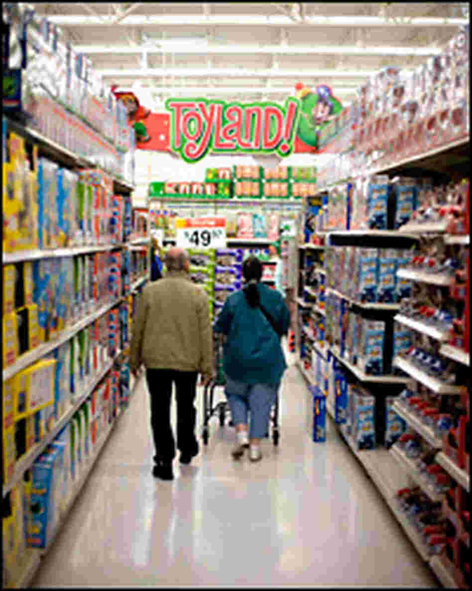 Holiday shoppers walk the aisles of the toy section in a store in New Jersey.
