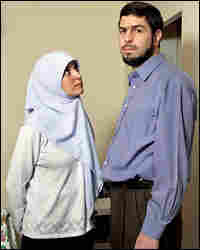 Syrian-born Canadian Maher Arar and his wife, Monia Mazigh, stand in their Ottawa home.