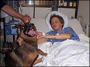Jamie Mangan  and her dog Rex at Walter Reed