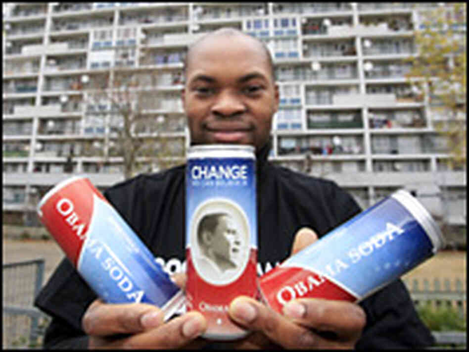 French businessman Jean-Jacques Attisso shows cans of his Obama Soda in La Courneuve.