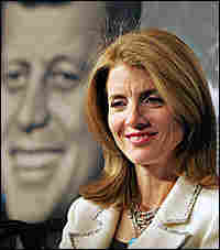 Caroline Kennedy sits in front of an image of her late father, President John F. Kennedy