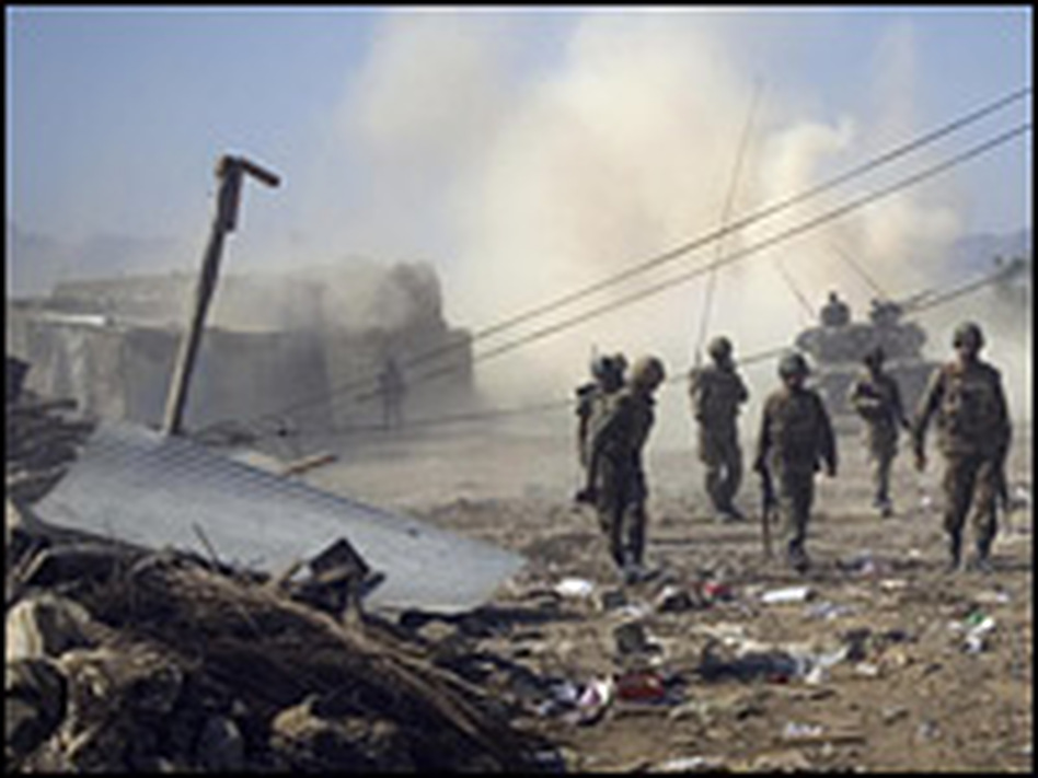 Pakistani soldiers walk past damaged houses in Loisam, in the Bajaur tribal region, in October.