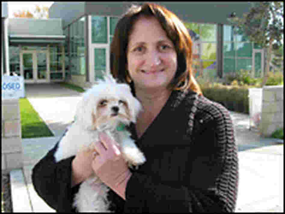 Debbie Garringer of Claremont, Calif., holds one of the two dogs she won at the auction.