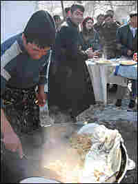 """The cook prepares """"plov"""" for the wedding."""