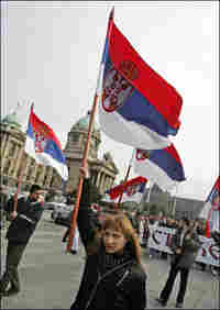 Serbian students wave flags during a protest in downtown Belgrade.