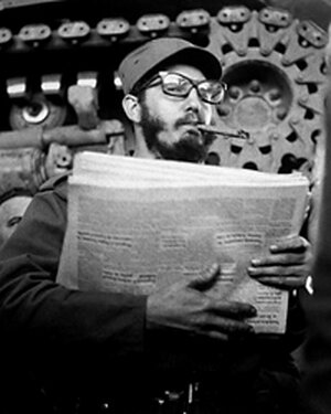 Fidel Castro stands in front of a tank, en route from Sierra Maestra to Havana in early 1959