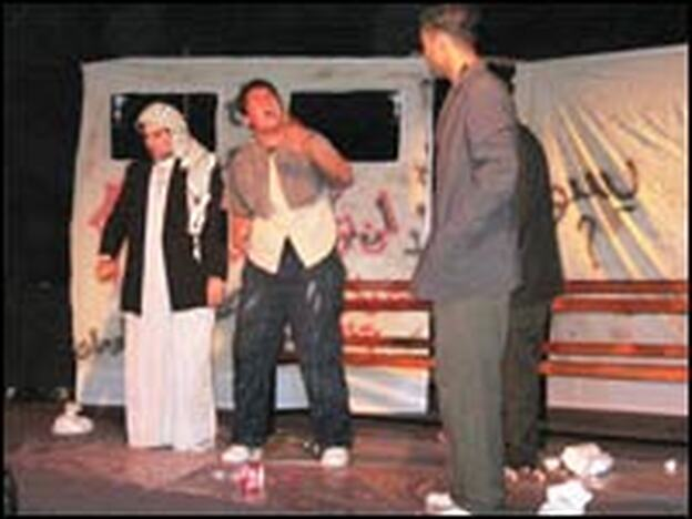"Actors perform ""The Journey"" on the stage at Freedom Theatre."