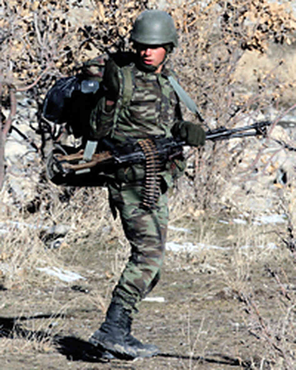 A Turkish soldier patrols an area near Sirnak.