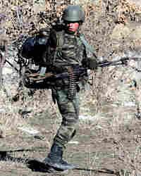 A Turkish soldier patrols an area near Sirnak.