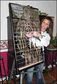 Dana Shafman shows where to aim the Taser at a Taser party in Fairfield, Conn.