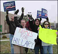 "Clinton campaign volunteers brave the February cold to hold an afternoon ""honk and wave"" in Toledo"