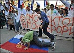 Kosovo Serbian youths kiss the Serbian national flag