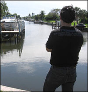 Bahjat, an Iraqi refugee, stands in the backyard of his new home in Cape Coral, Fla.