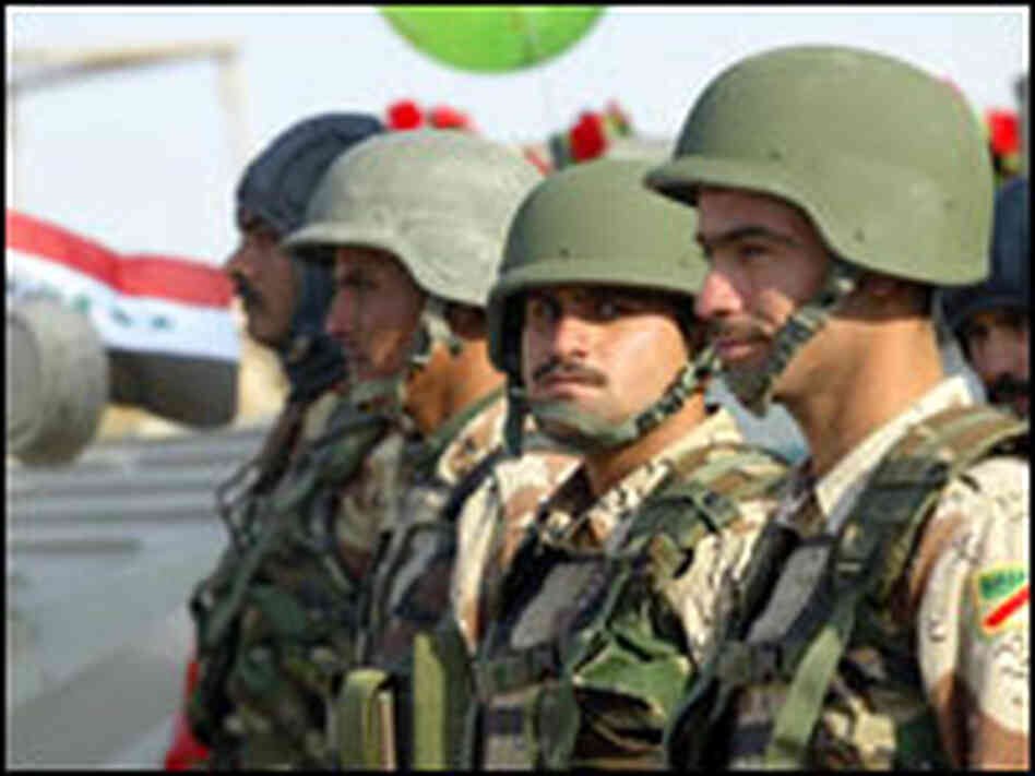 Iraqi soldiers attend celebrations for Army Day in Basra.
