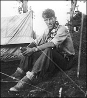 New Zealand-born mountaineer Sir Edmund Hillary sits at base camp in Nepal in May 1953.