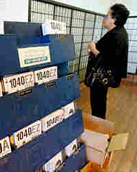 Federal tax forms on display at a U.S. Post Office in Palo Alto, Calif.