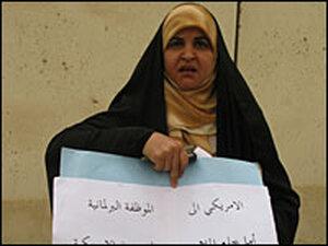 Farah al-Jaberi holds protest sign