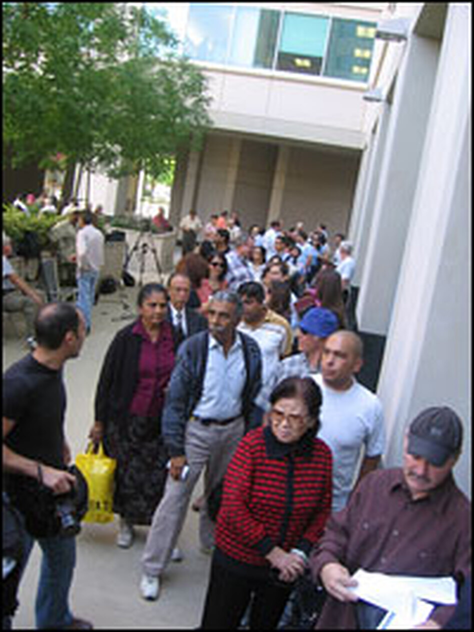 Customers line up outside IndyMac bank in Pasadena, Calif., to withdraw their funds. The Federal Insurance Deposit Corporation took over the bank on Friday.
