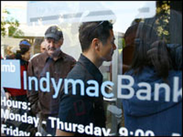 People enter an IndyMac Bank branch in Pasadena, Calif., after waiting in line with hundreds of other customers, July 14.