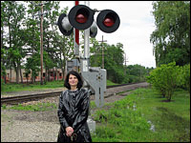 Barrington Village President Karen Darch stands at one of the EJ&E crossings that she fears will see an enormous increase in freight train traffic.