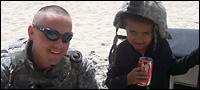 Bogar with a boy in Afghanistan.