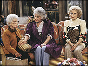 Estelle Getty in a 'Golden Girls' scene with Bea Arthur and Betty White.