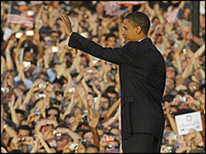 Sen. Barack Obama waves to the crowd after making a speech in front of the Victory Column in Berlin.
