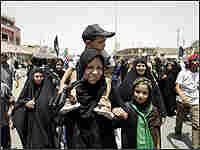 Shiite pilgrims approach the shrine of Imam Musa al-Kadham.