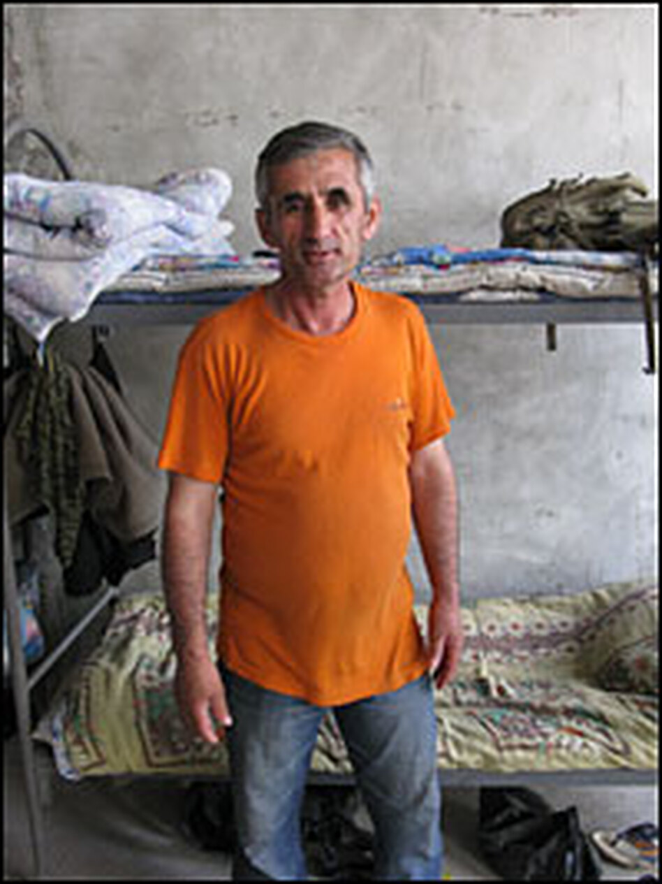 Tajik construction worker Said Chekhanov supports 10 family members back home. He says working conditions in Russia are difficult. Work begins at 8 a.m. and ends at 10 p.m. Workers requesting a day off risk being fired.