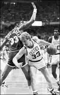 Larry Bird drives around Kareem Abdul-Jabbar in an NBA championship game in 1987.