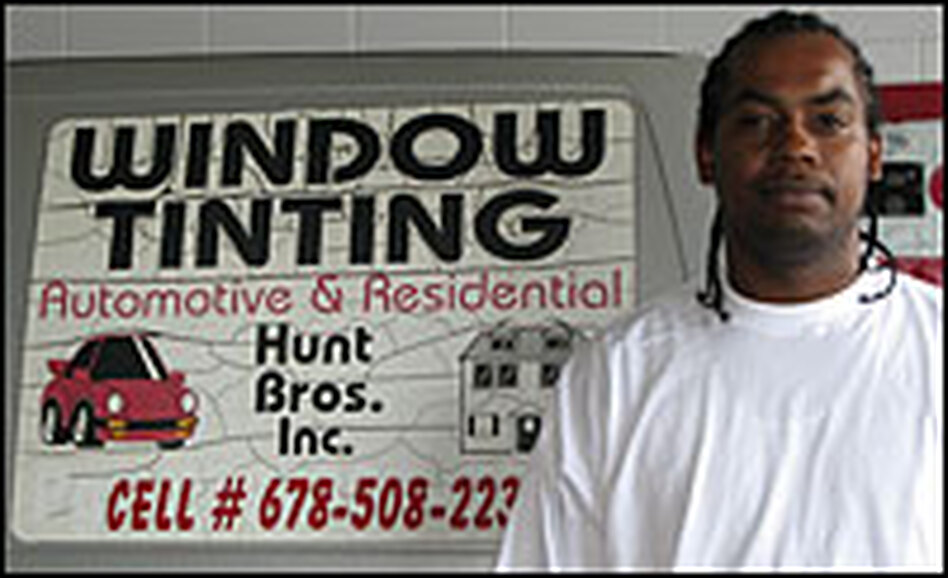 Chris Hunt, standing in his Atlanta auto-detailing shop, is fighting a federal prosecutor to get his $5,581 back.