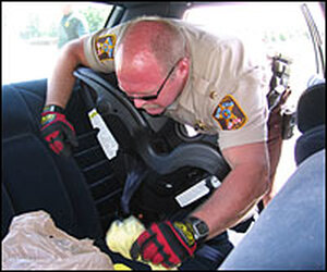 Eddie Ingram searches car for contraband.