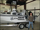 Sgt. Chris Sears and a river patrol boat.