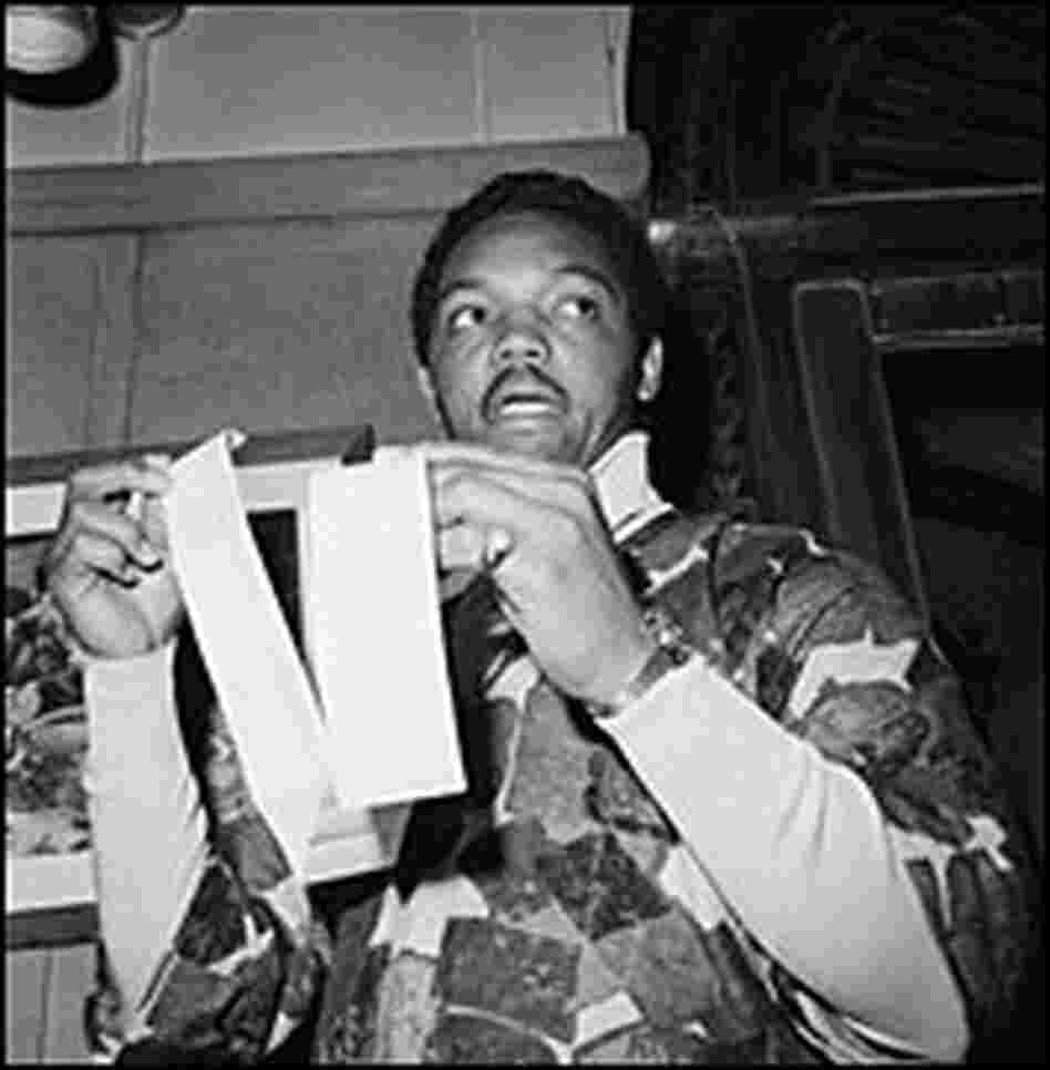 The Rev. Jesse Jackson holds up a lunch bill.