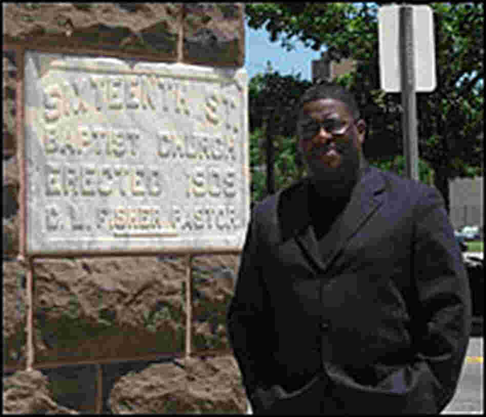 The Rev. Arthur Price Jr. stands near the church.