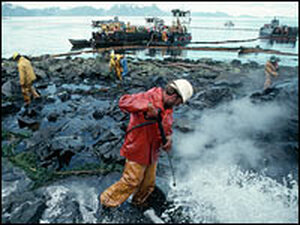 Workers clean oil-covered rocks in Alaska near the site of the Exxon Valdez oil spill in 1989.