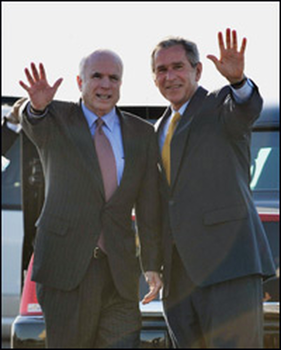 Arizona Republican Sen. John McCain (left) with President George W. Bush on May 27 before Bush's departure from Phoenix Sky Harbor International Airport. Bush was leaving Phoenix after attending a fundraiser for McCain.
