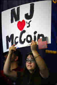 A McCain supporter holds a sign at a rally on Feb. 4 in New Jersey.