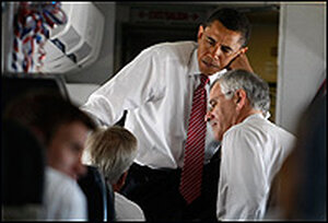A senior adviser to Obama, Richard Danzig, talks to the candidate on a plane.