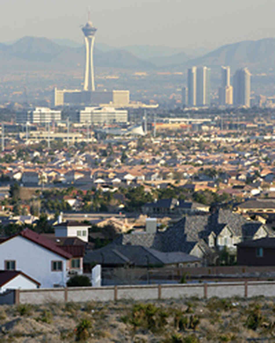 The Las Vegas Strip is seen behind residential neighborhoods.