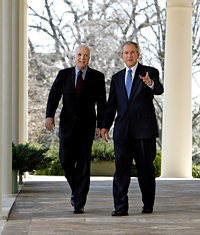 President Bush and Sen. John McCain walk from the Oval Office to the Rose Garden.