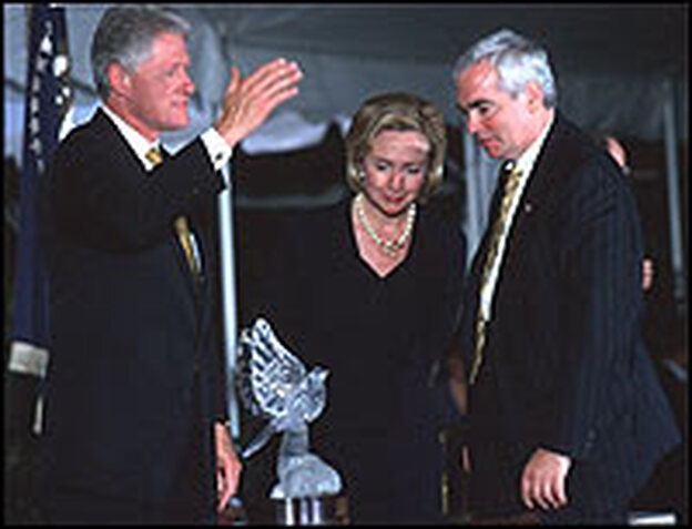 President Bill Clinton, Hillary Clinton and Brian O'Dwyer view the Paul O'Dwyer Peace and Justice Award after the president was awarded it in 1998 for his efforts to bring peace to Northern Ireland.