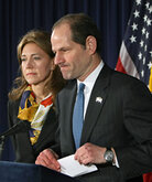 New York Gov. Eliot Spitzer announces his resignation with his wife, Silda, at his office.